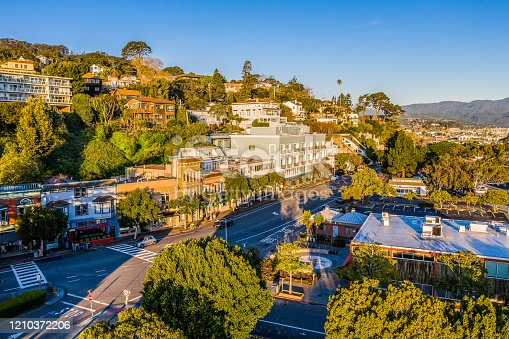 An aerial view of Sausalito on a golden morning. The sun is shining on the hillside and a clear view of downtown.