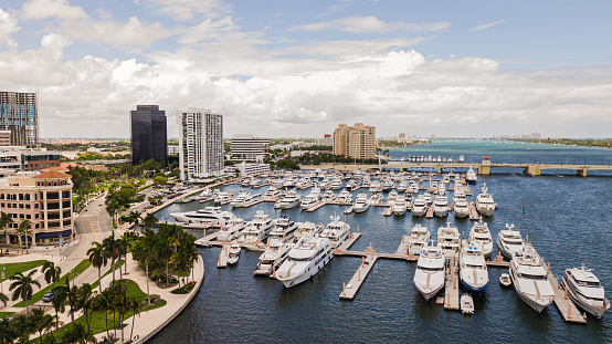 Aerial Footage of Downtown West Palm Beach, Florida Inlet Waterfront & Skyline in May of 2021