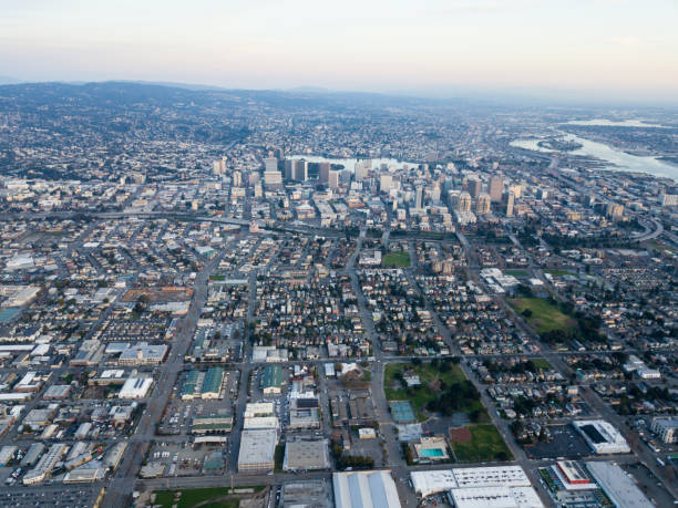 Aerial View of Dowtown Oakland, California Incorporated in 1852, the city of Oakland is the eighth most populated city in California and serves as an important port and trade center. It lies just across the bay from San Francisco. alameda california stock pictures, royalty-free photos & images