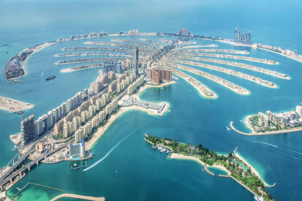 Aerial view of Dubai Palm Jumeirah island, United Arab Emirates Aerial view of Dubai Palm Jumeirah island, United Arab Emirates dubai stock pictures, royalty-free photos & images
