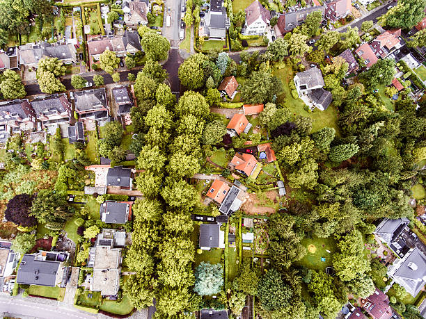 aerial view of dutch town, houses with gardens, green park - pays bas photos et images de collection