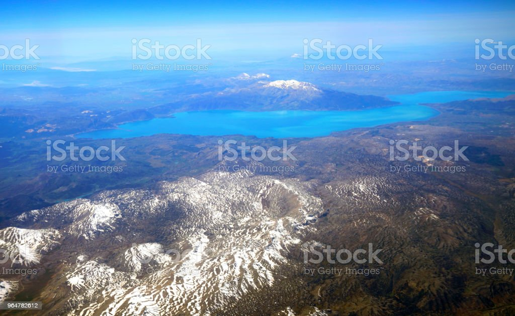 Aerial view of Egirdir lake and snow covered mountains in Isparta, Turkey royalty-free stock photo