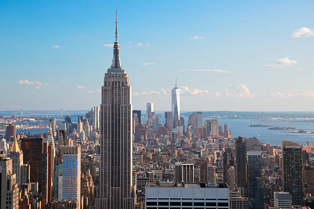 Aerial view of Empire State Building & Manhattan Amazing aerial view of Manhattan dominated by Empire State Building. Far is visible the Statue of Liberty. empire state building stock pictures, royalty-free photos & images