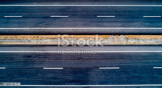 94502198 istock photo Aerial view of empty road - highway 1077257646