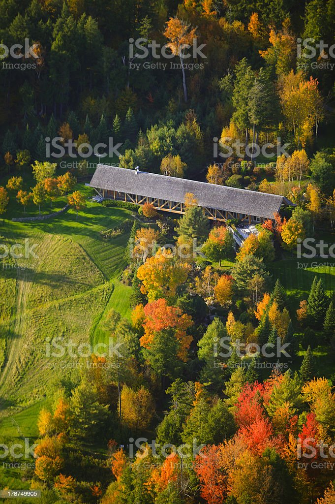 Aerial view of fall foliage and a covered bridge stock photo