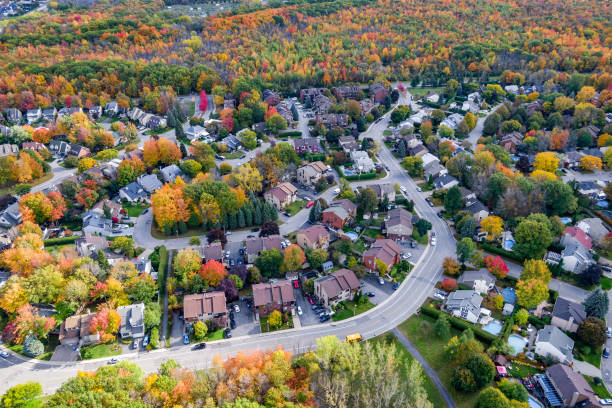 Aerial View of Family Homes in Residential Neighbourhood Showing Trees Changing Color in Fall Season, Montreal, Quebec, Canada stock photo