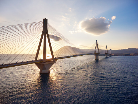 Aerial view of famous Rion-Antirrio bridge on susnet, near Patra city in Greece.