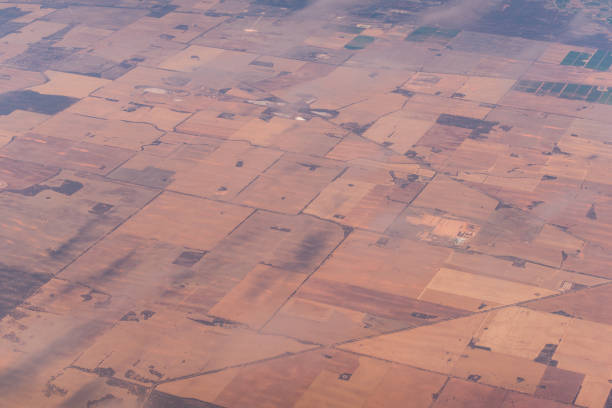 Aerial view of farm fields pattern. Agriculture landscape view from above Aerial view of farm fields pattern. Agriculture landscape birds eye view monoculture stock pictures, royalty-free photos & images