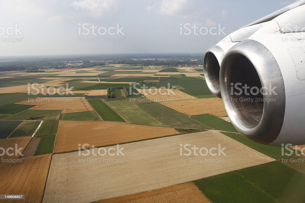 aerial view of farmland over flying airplane royalty-free stock photo