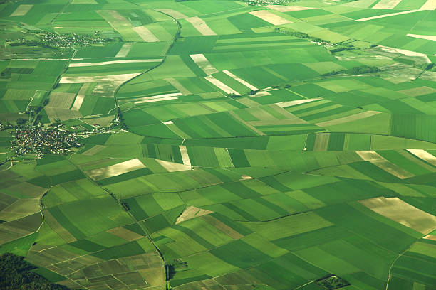 aerial view of fields in france - cultivated land stock pictures, royalty-free photos & images