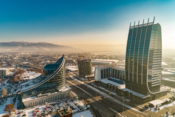Aerial view of financial business district with heavy air pollution smog around Aerial view of financial business district with heavy air pollution smog around. The scene takes place near financial and industrial district near or short after sunset outdoors in the city of Sofia, Bulgaria (Eastern Europe). The footage is taken with DJI Phantom 4 Pro video drone / quadcopter. bulgaria stock pictures, royalty-free photos & images