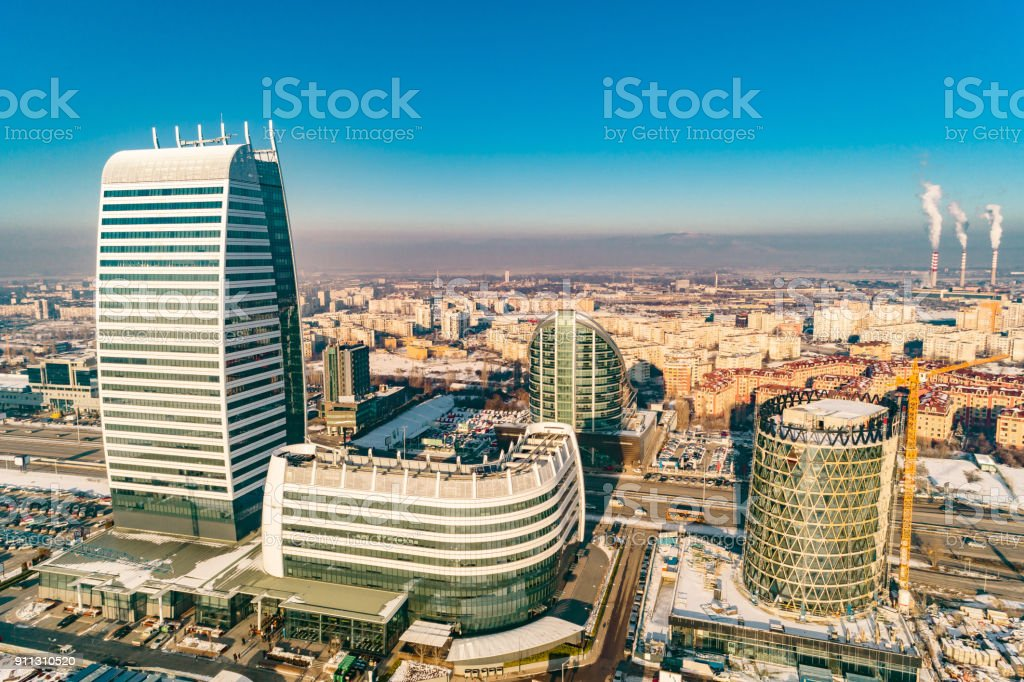 Aerial view of financial business district with power plant factory smoking chimneys in background in Sofia, Bulgaria