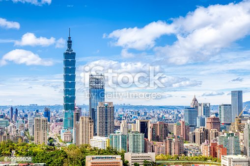 Cityscape of Taipei with skyscraper under dramatic clouds at blue sky in Taiwan, Asia