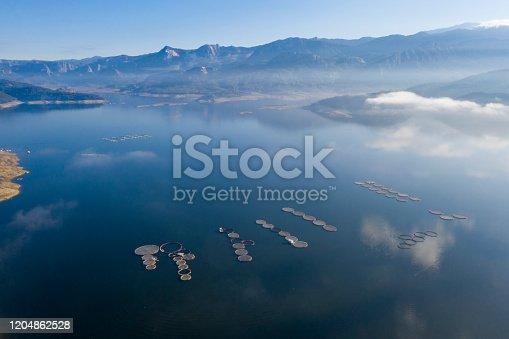 Aerial view of fish farm in lake. Taken via drone.