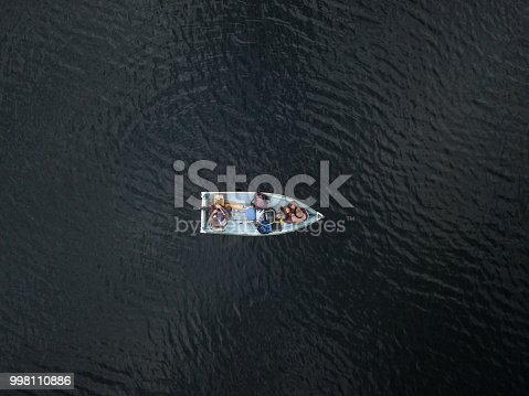 Aerial View of Fishermans Fishing From a Boat on lake in forest, Quebec, Canada