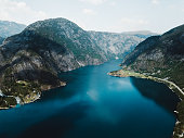 Drone photo of picturesque fjord with mountains and lake in South Norway