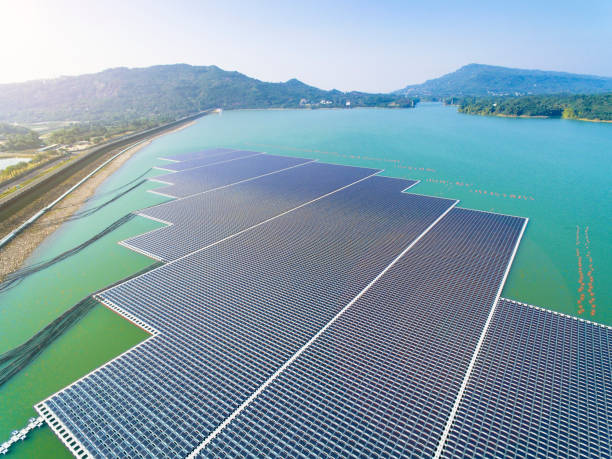 aerial view of Floating solar panels or solar cell Platform on the lake aerial view of Floating solar panels or solar cell Platform on the lake floating on water stock pictures, royalty-free photos & images