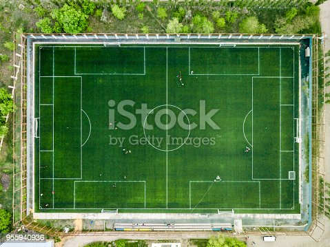 istock aerial view of football field in the forest stadium 955940936