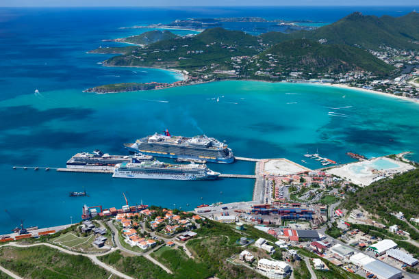 Philipsburg, St. Maarten, Dutch West Indies - October 24, 2012: aerial view of four cruise ships at the dock: Norwegian Gem; Celebrity Summit, Oasis of the Seas and Carnival Dream
