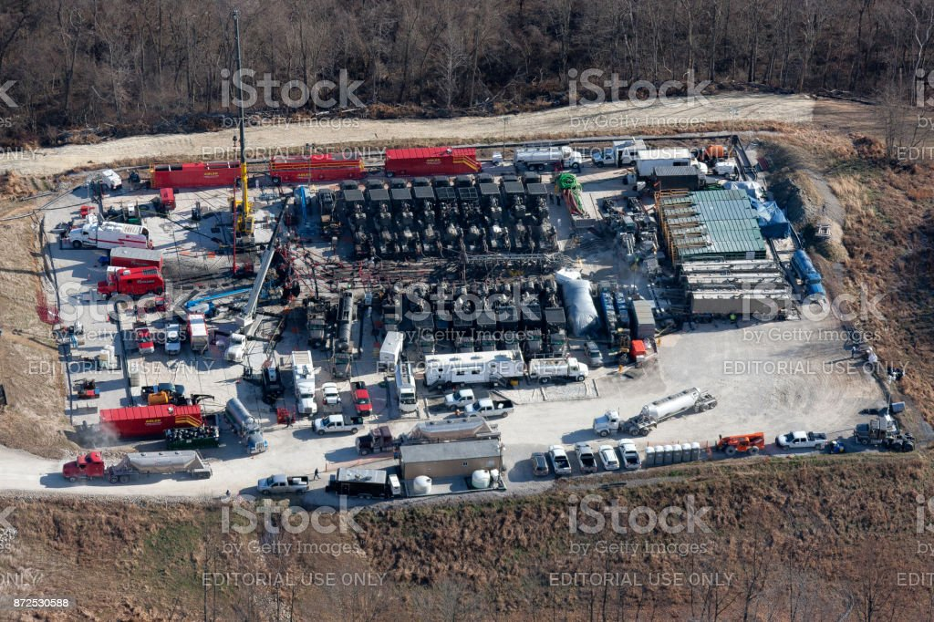 Aerial view of fracking a natural gas well stock photo