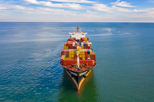 Aerial view of freight ship with cargo containers.