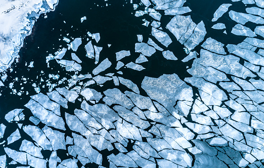 Aerial view of Frozen Cracked ice floe floating on Baltic sea,Finland