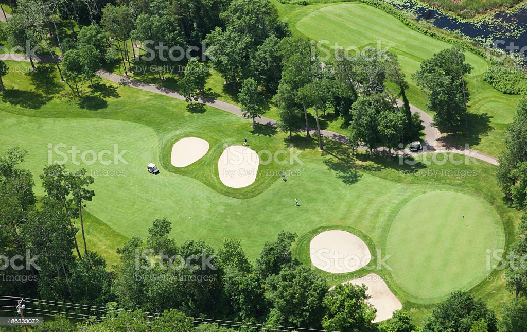 Aerial view of golf course fairway and green stock photo