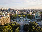 Aerial view of Grand Army Plaza in Brooklyn on a sunny summer morning with Manhattan in the background