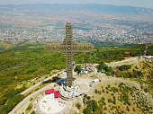 Aerial view of Great cross of steel structure against cityscape, Macedonia.