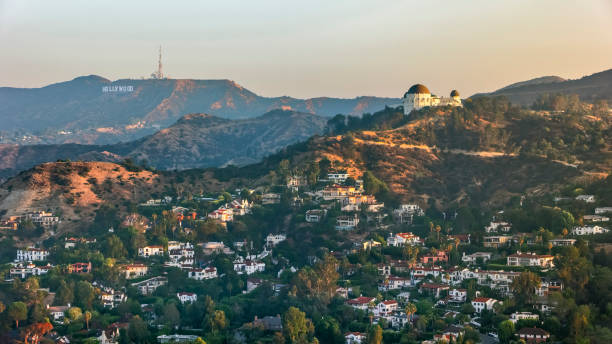 Aerial view of Griffith Observatory with the Hollywood Sign seen in the distance Aerial view of the Griffith Observatory on Mount Hollywood and the Hollywood Sign seen in the distance, California, USA. hollywood california stock pictures, royalty-free photos & images