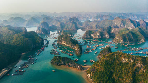 Aerial view of Halong Bay in Vietnam Scenic aerial view of Halong Bay in Vietnam  at sunset bay of water stock pictures, royalty-free photos & images