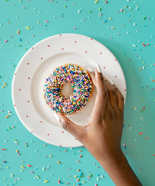 Aerial view of hand getting donut stock photo