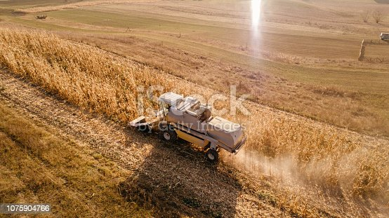 1072634078 istock photo Aerial view of harvester collecting harvest, harvesting the fields 1075904766