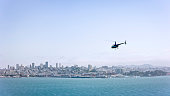 Aerial view of a helicopter flying across the San Francisco Bay with a nice view of the city on a sunny day, California, USA.