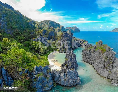 Aerial view of Hidden beach in Matinloc Island, El Nido, Palawan, Philippines - Tour C route - Paradise lagoon and beach in tropical scenery