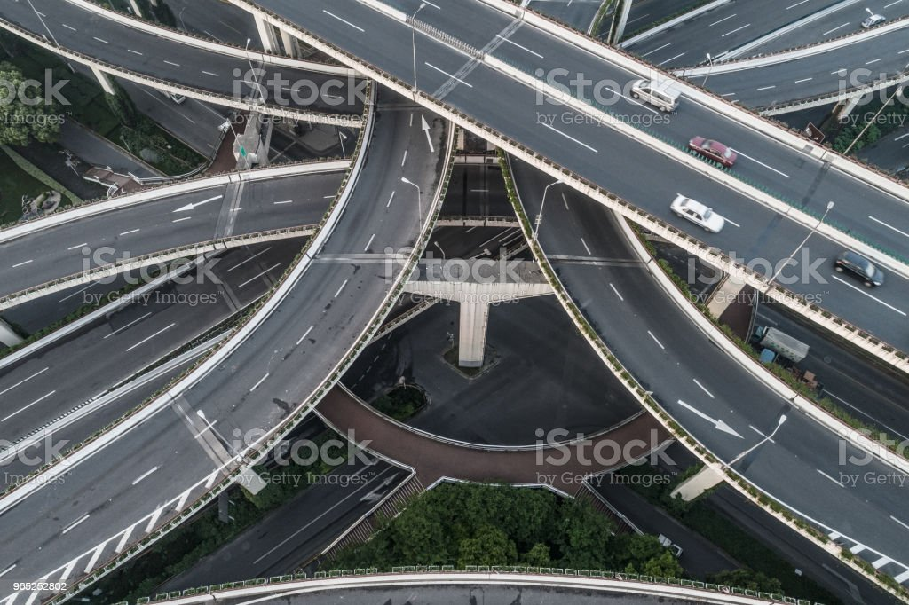 Aerial view of highway and overpass in city on a cloudy day royalty-free stock photo