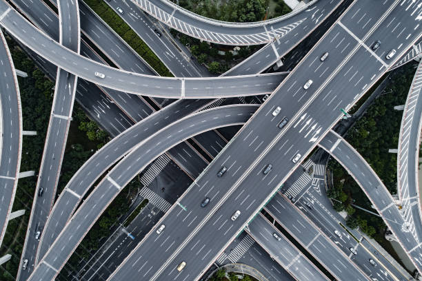 aerial view of highway and overpass in city - estrada imagens e fotografias de stock