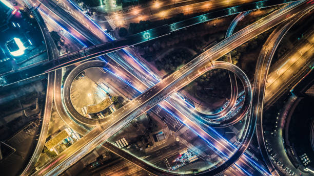aerial view of highway at night Multiple Lane Highway, Overpass, Elevated Road, Road, Road Intersection elevated road stock pictures, royalty-free photos & images