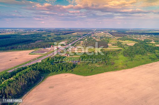 1155573645istockphoto Aerial view of highway, countryside and arable fields 1145816853