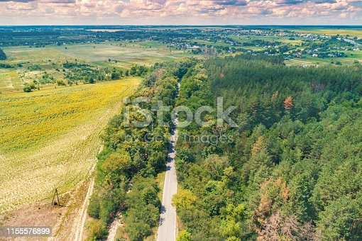 1155573645istockphoto Aerial view of highway, countryside, wood, and fields 1155576899