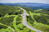 Aerial view of highway going through verdant hills, San Francisco bay area, California