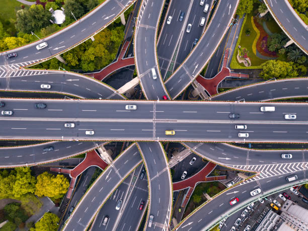 Aerial view of highway junctions shape letter x cross. Bridges, roads, or streets with trees in transportation concept. Structure shapes of architecture in urban city, Shanghai Downtown, China. stock photo
