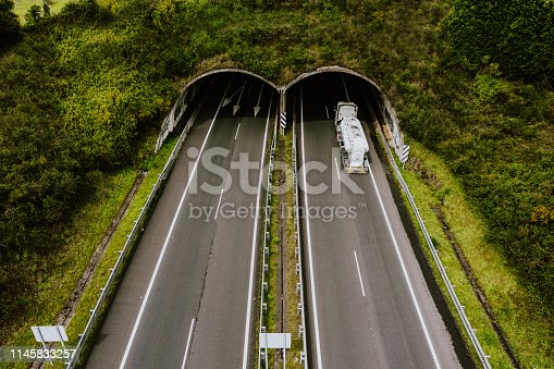 1023119734 istock photo Aerial view of highway tunnel in mountains. 1145833257