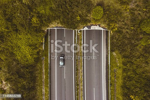 istock Aerial view of highway tunnel in mountains. 1145833259