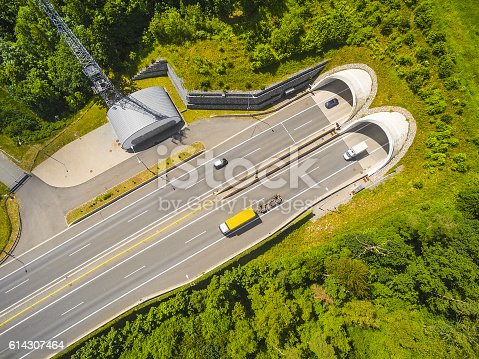 istock Aerial view of highway tunnel in mountains. 614307464