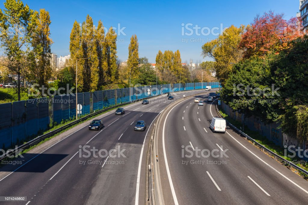 Aerial view of highway with multiple lanes and cars. Cars on highway...