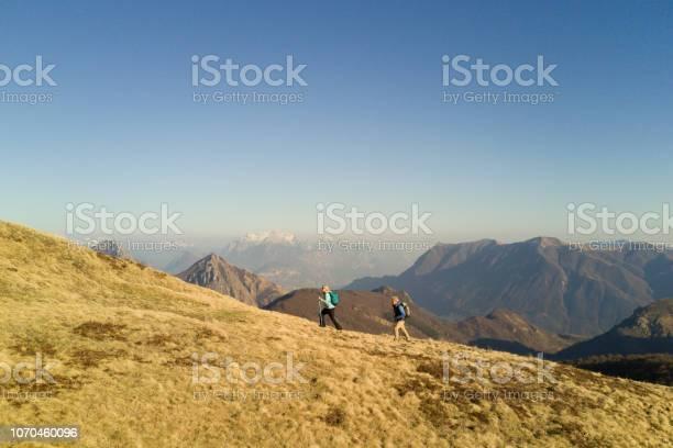 Photo of Aerial view of hiking couple enjoying mountains