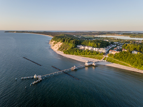 Aerial view of historical pier and the resort of Sellin on Ruegen island at sunrise