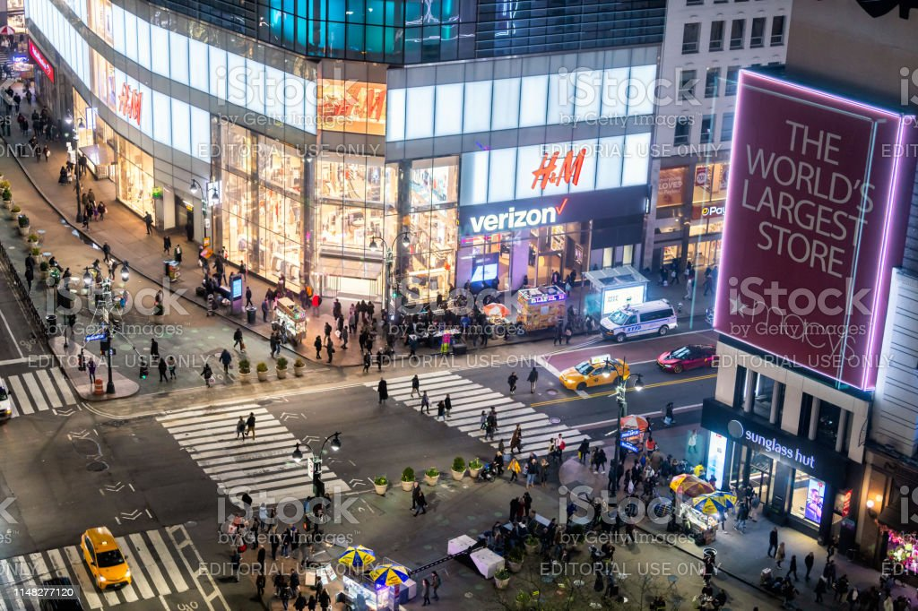 Aerial View Of Hm And Macys Stores In New York City Herald Square With People Crossing Crosswalk At Dark Night Stock Photo Download Image Now Istock