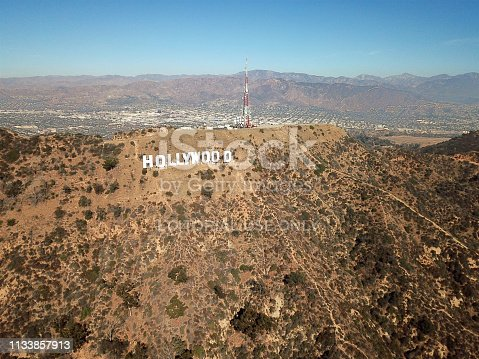 Aerial view of Hollywood sign during hot dry summer season. Hollywood, Los Angeles, California. Famous touristic sightseeing attraction.
